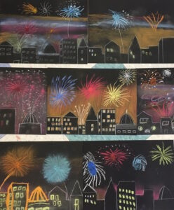A photo of individual artworks depicting a nighttime skyline with fireworks in the sky. The individual pieces placed side by side create a larger, continuous piece.