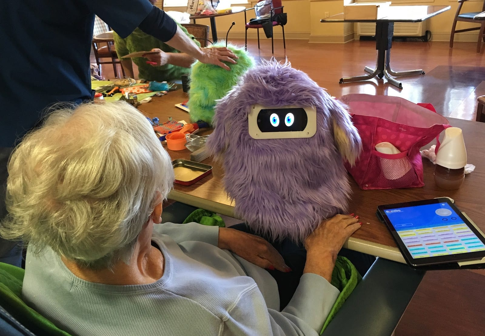 FAMbot interacting with elderly woman