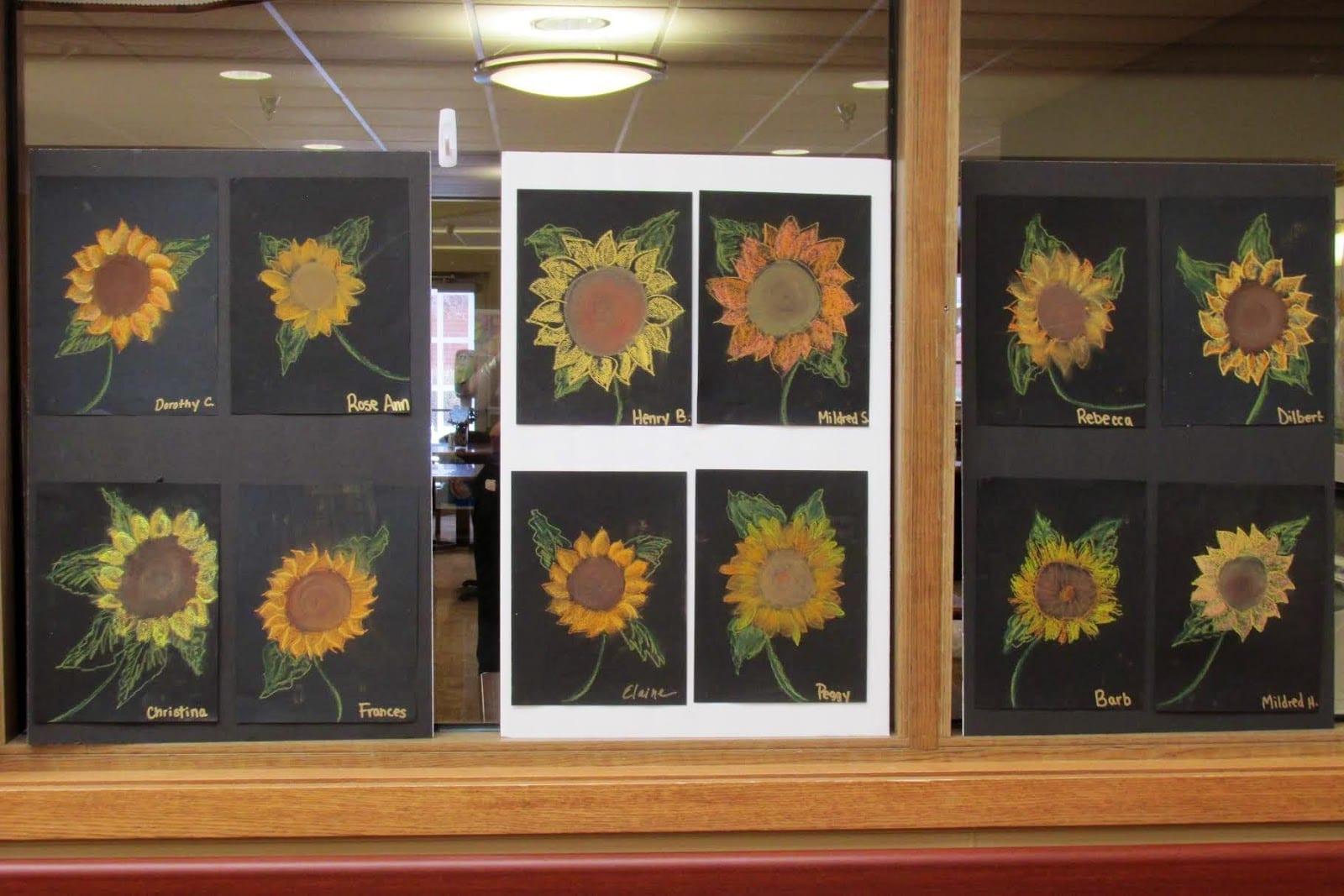 Image of sunflower artwork on display.