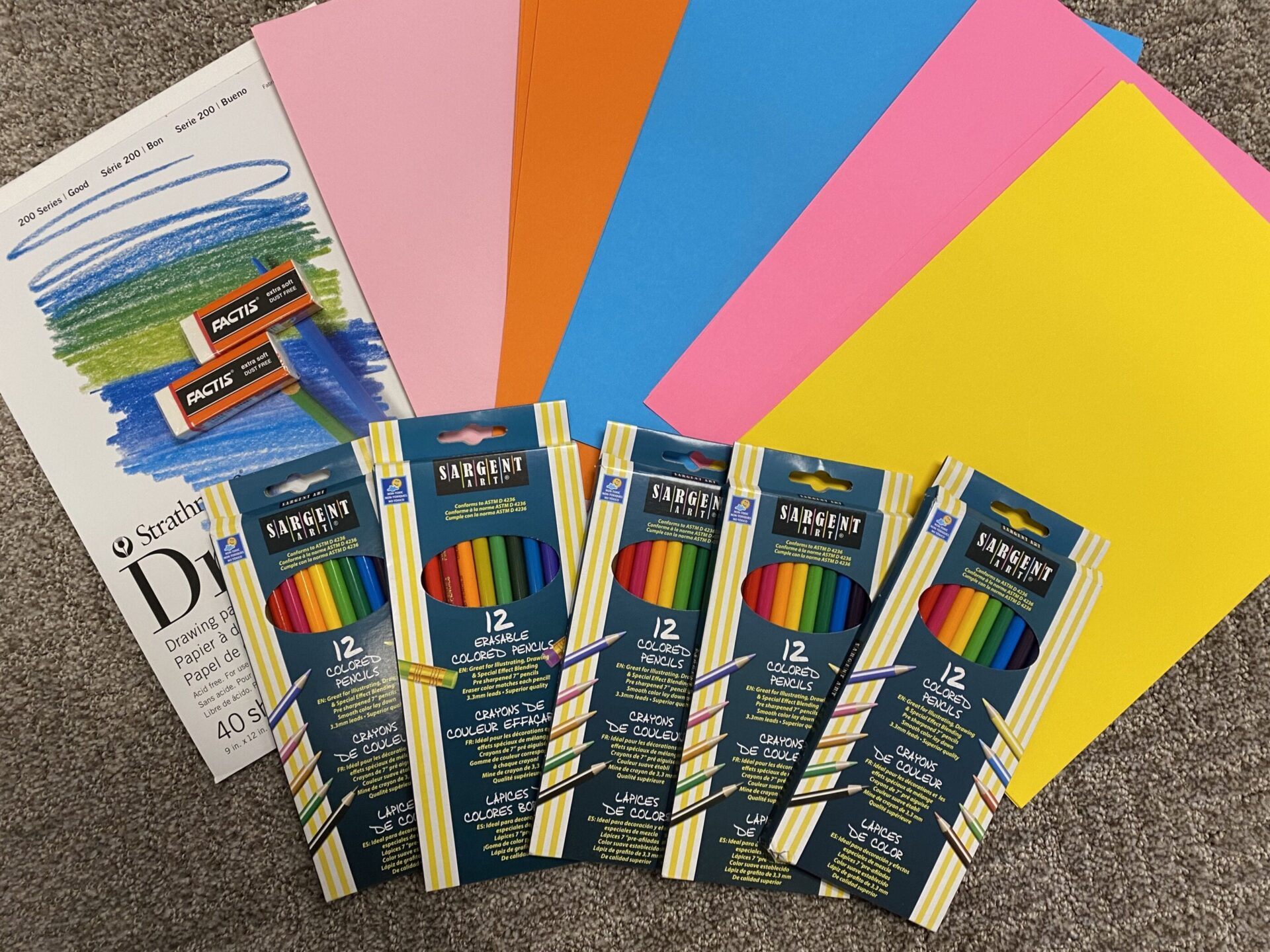 Colored pencils, erasers, and drawing paper.
